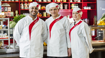 3 Sodexo chefs standing in front of a counter